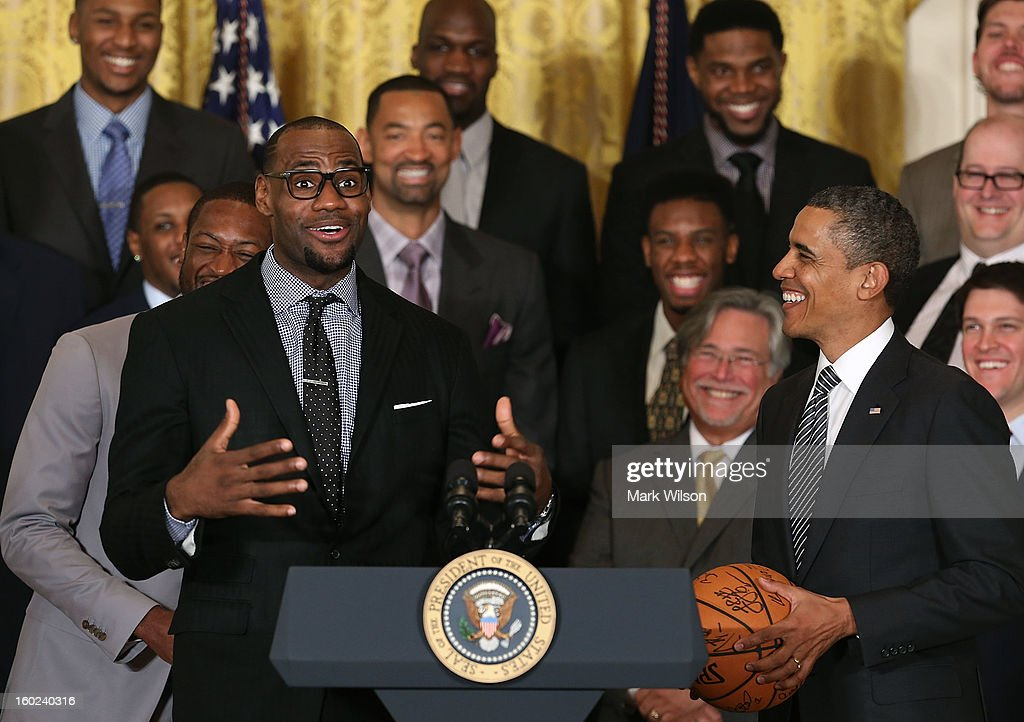 Miami Heat player LeBron James (L) speaks to U.S. President Barack Obama (R) during an event to honor the NBA champion Miami Heat in the East Room at the White House on January 28, 2013 in Washington, DC. President Barack Obama congratulated the 2012 NBA champions for claiming their third NBA Championship by beating the Boston Celtics.