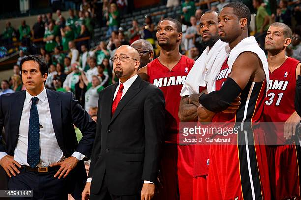 Miami Heat players Chris Bosh, LeBron James and Dwyane Wade, and head coach Erik Spoelstra and David Fizdale look on from the bench in the fourth...