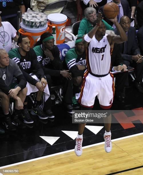 Miami Heat power forward Chris Bosh sticks a three pointer directly in front of the Boston Celtics bench during the fourth quarter. Boston Celtics...