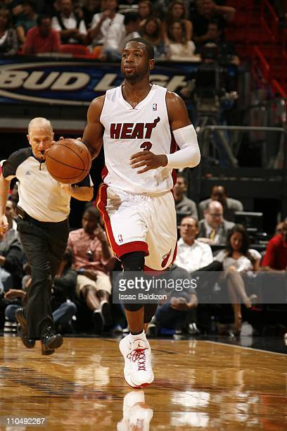 Miami Heat shooting guard Dwyane Wade brings the ball up court during the game against the Denver Nuggets on March 19 2011 at American Airlines Arena...