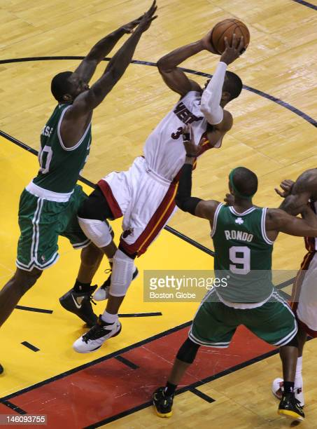 Miami Heat shooting guard Dwyane Wade loses his balance but still drains a fall away jumper in the fourth quarter. Boston Celtics NBA basketball,...