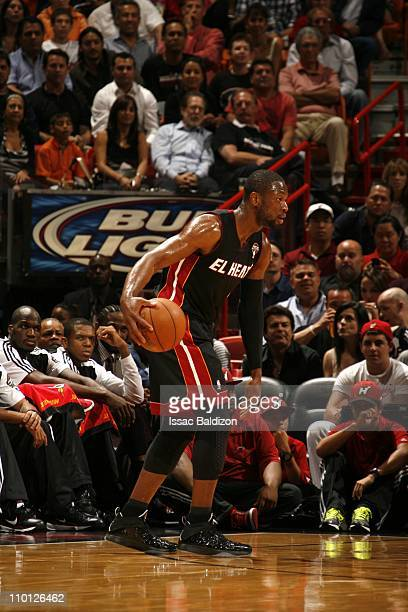 Miami Heat shooting guard Dwyane Wade protects the ball during the game against the San Antonio Spurs on March 14 2011 at American Airlines Arena in...