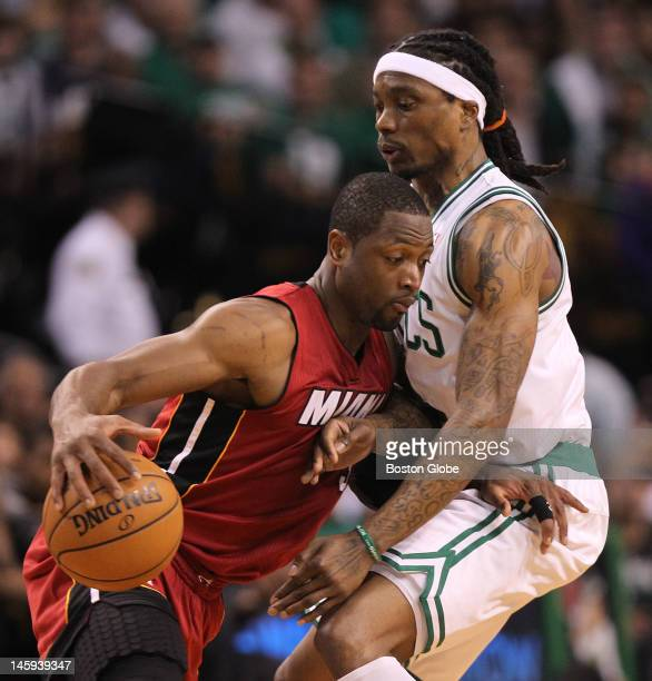 Miami Heat shooting guard Dwyane Wade tries to get past Boston Celtics shooting guard Marquis Daniels in the first quarter Boston Celtics NBA...