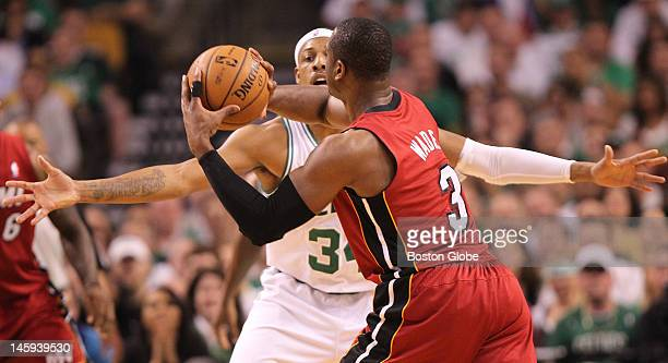 Miami Heat shooting guard Dwyane Wade tyres to get pass around Boston Celtics small forward Paul Pierce in the first quarter. Boston Celtics NBA...