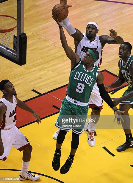 Miami Heat small forward LeBron James comes from behind to block this attempted layup by Boston Celtics point guard Rajon Rondo at the end of the...