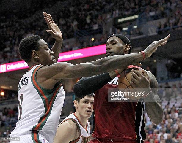 Miami Heat small forward LeBron James is pressured by Milwaukee Bucks center Larry Sanders during firstquarter action in Game 4 of the NBA's Eastern...