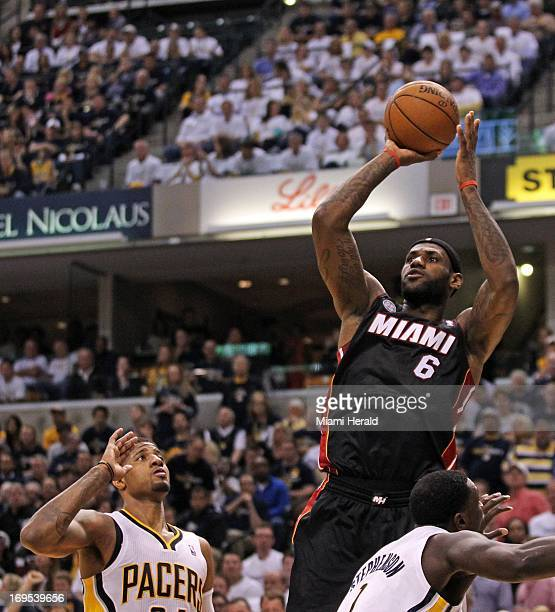 competitive price fd00b e2d1b Miami Heat small forward LeBron James shoots over Indiana Pacers small  forward Paul George during the
