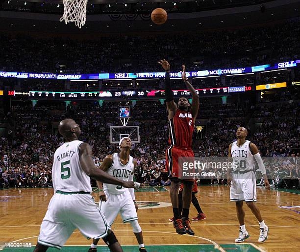 Miami Heat small forward LeBron James shoots over the top of Boston Celtics power forward Kevin Garnett , Boston Celtics shooting guard Ray Allen ,...