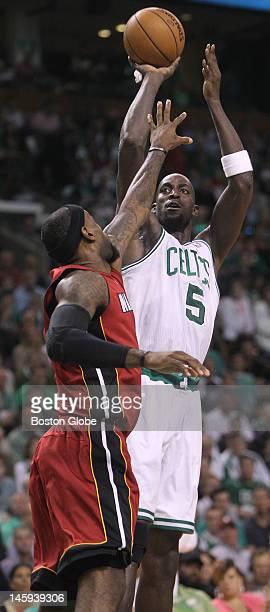 Miami Heat small forward LeBron James tries to block Boston Celtics power forward Kevin Garnett as he takes a shot in the first quarter. Boston...