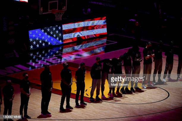 Miami Heat stand during the National Anthem prior to the game against the Atlanta Hawks during the quarter at American Airlines Arena on February 28,...