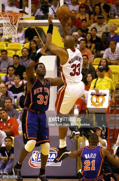 Miami Heat's Alonzo Mourning shoots over New York Knicks' Patrick Ewing in Game 1 of the NBA Eastern Conference playoffs in Miami. The Heat won,...