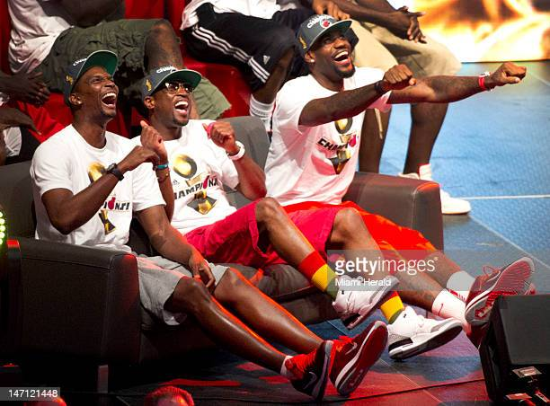Miami Heat's Chris Bosh from left Dwyane Wade and LeBron James laugh at themselves is they view a video called the Heatles mocking the Beatles during...