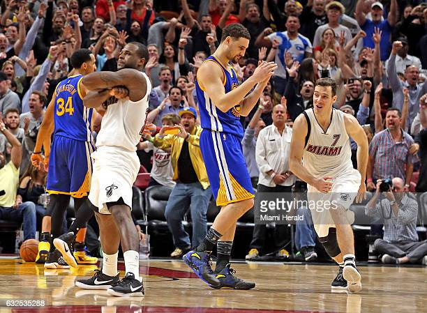Miami Heat's Dion Waiters poses for the fans after shooting a basket over the Golden State Warriors' Klay Thompson in the final seconds of the game...