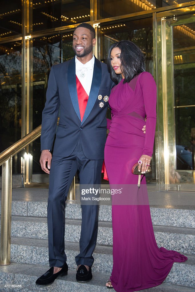 Miami Heat's Dwyane Wade (L) and Actress Gabrielle Union depart the Trump International Hotel for the 'China: Through The Looking Glass' Costume Institute Benefit Gala on May 4, 2015 in New York City.