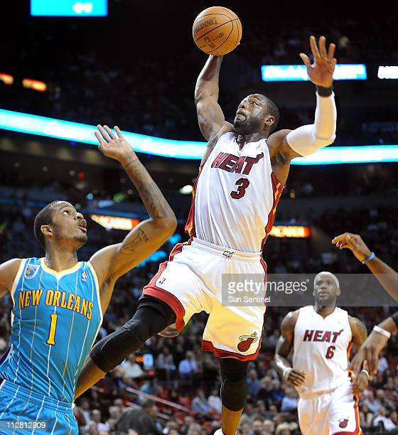 Miami Heat's Dwyane Wade drives to the basket against New Orleans Hornets' Trevor Ariza at the American Airlines Arena in Miami Florida Monday...