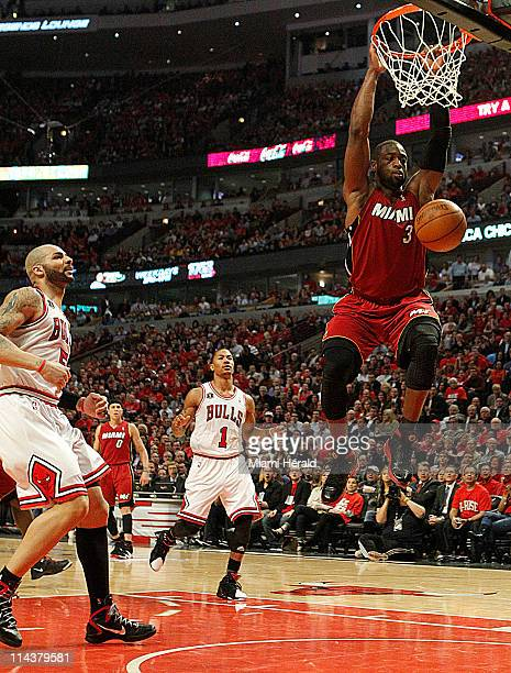 Miami Heat's Dwyane Wade dunks the ball as Chicago Bulls' Carlos Boozer and Derrick Rose watch in the second quarter during Game 2 of the NBA Eastern...