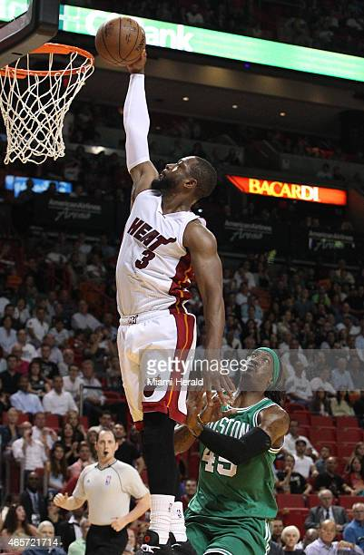 Miami Heat's Dwyane Wade dunks the ball during the first quarter on Monday March 9 at AmericanAirlines Arena in Miami