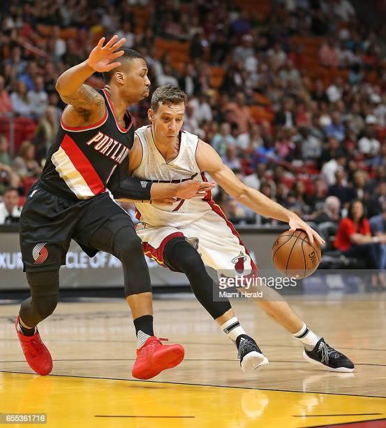 Miami Heat's Goran Dragic drives to the basket past Portland Trail Blazers' Damian Lillard on Sunday March 19 2017 in Miami Fla