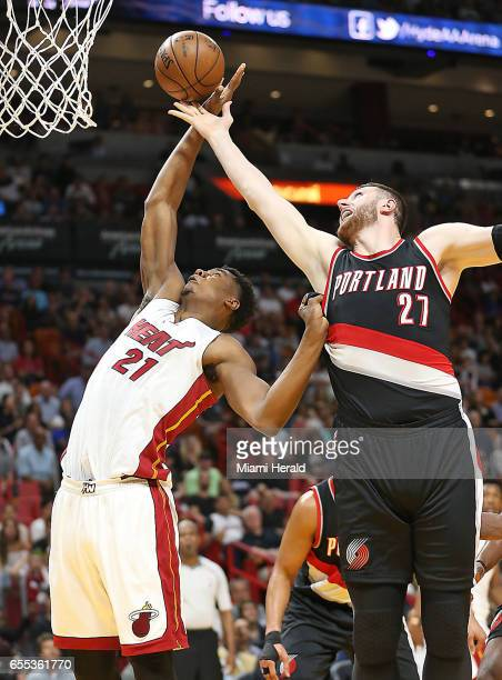 Miami Heat's Hassan Whiteside and Portland Trail Blazers' Jusuf Nurkic go for a loose ball on Sunday March 19 2017 in Miami Fla