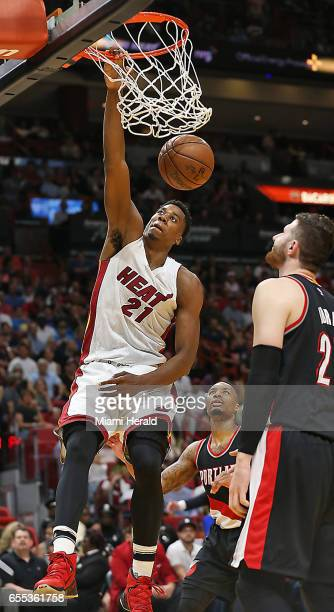 Miami Heat's Hassan Whiteside dunks the ball against the Portland Trail Blazers on Sunday March 19 2017 in Miami Fla