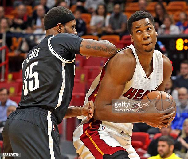 Miami Heat's Hassan Whiteside gets pushed in the back by Brooklyn Nets' Trevor Booker in the first quarter on Monday Jan 30 2017 at the...