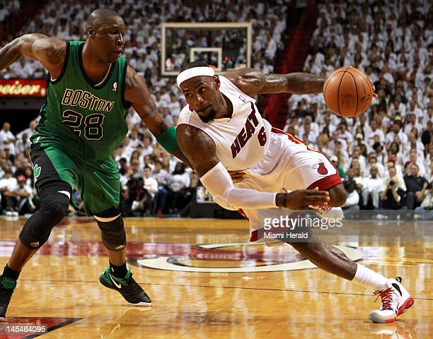 Miami Heat's LeBron James drives to the basket past Boston Celtics' Mickael Pietrus in the first quarter during Game 2 of the NBA Eastern Conference...