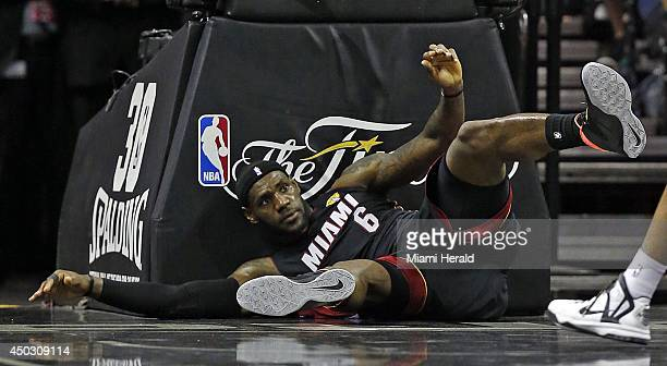 Miami Heat's LeBron James falls to the court during the first quarter in Game 2 of the NBA Finals at the ATT Center in San Antonio on Sunday June 8...