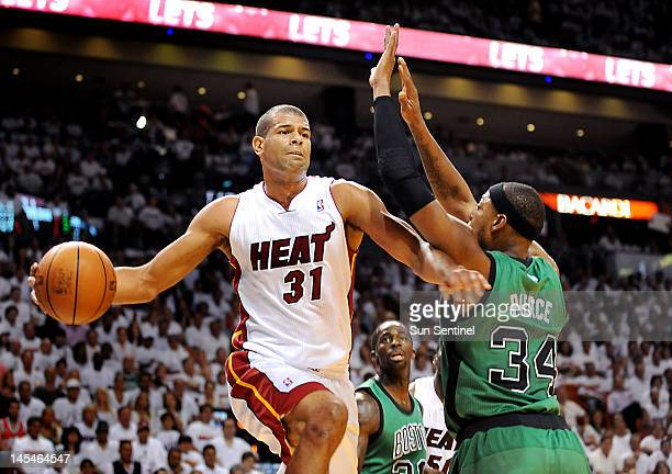 Miami Heat's Shane Battier passes the ball while Boston Celtics' Paul Pierce defends in Game 2 of the NBA Eastern Conference finals at...