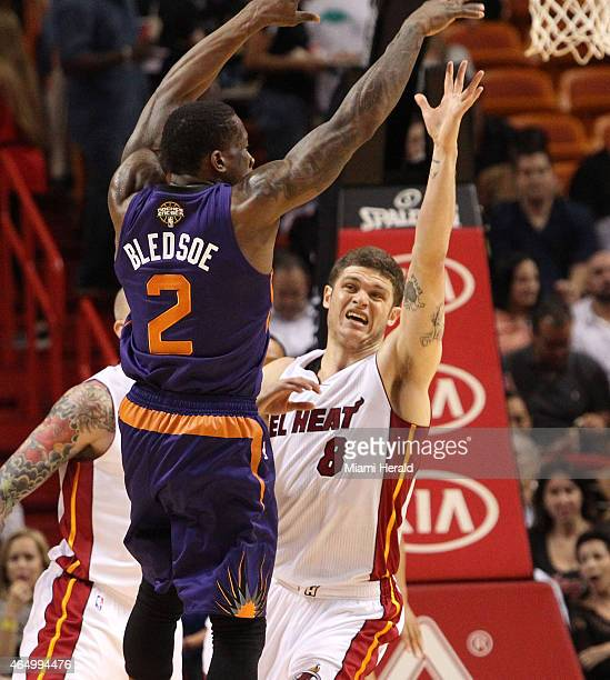 Miami Heat's Tyler Johnson tries to block a pass by Phoenix Suns' Eric Bledsoe during the second quarter on Monday, March 2 at AmericanAirlines Arena...