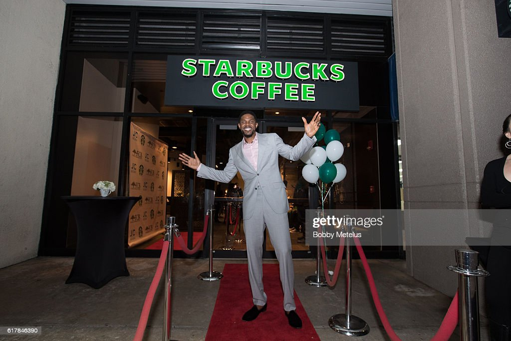 Miami Heat's Udonis Haslem stands in front of his new Starbucks location at the VIP preview of Starbucks hosted by Udonis Haslem and Ramona Hall at Jackson Memorial Medical Center on October 24, 2016 in Miami, FL.