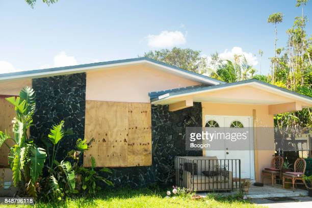 Miami Home Boarded Up with Plywood After Hurricane Irma