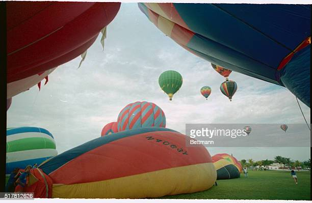 Hot air balloons are inflated and take off to become hounds to chase the hare at the Great Sunrise Hot Air Balloon Race 2/26 About 35 of the colorful...