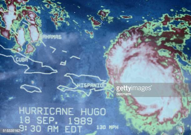 Hurricane Hugo is shown as a 1030 am color satellite photo Hugo has sustained winds of 105 mph and is moving to the northwest at 12 mph from a noon...