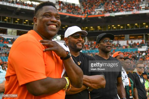 Miami Hurricanes alumni and former NFL players Warren Sapp Ray Lewis Michael Irvin Edgerrin James and Clinton Portis attend the game between the...