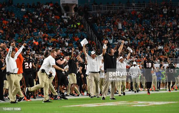 Miami Hurricanes bench celebrates on the sidelines during the game against the North Carolina Tar Heels at Hard Rock Stadium on September 27 2018 in...