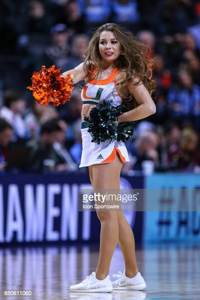 Miami Hurricanes cheerleader during the first half of the 2017 New York Life ACC Tournament third round game between the North Carolina Tar Heels and...