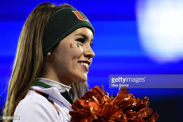 Miami Hurricanes cheerleader gazes toward the stands during the ACC Football Championship against the Clemson Tigers at Bank of America Stadium on...