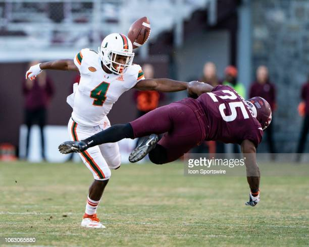 Miami Hurricanes Defensive Back Jaquan Johnson tackles Virginia Tech Running Back Steven Peoples and knocks the ball away for an incomplete pass...