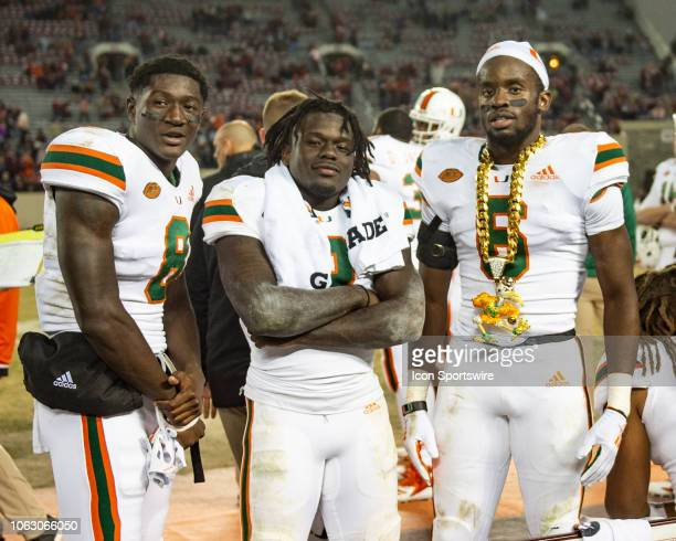 Miami Hurricanes Defensive Back Jhavonte Dean wears the turnover chain after getting an interception along with Miami Hurricanes Defensive Back DJ...