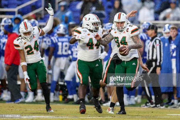 Miami Hurricanes fullback Realus George Jr. Celebrates with Miami Hurricanes punter Lou Hedley after a fake punt lead to a fourth down conversion...