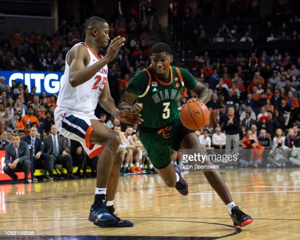Miami Hurricanes Guard Anthony Lawrence II dribbles the ball against Virginia Cavaliers Forward Mamadi Diakite during the second half of the Miami...