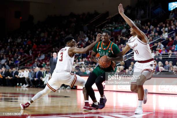 Miami Hurricanes guard Anthony Lawrence II drives between Boston College guard Jared Hamilton and Boston College forward Steffon Mitchell during a...