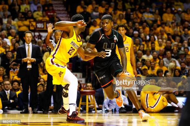 Miami Hurricanes guard Anthony Lawrence II drives to the net while Minnesota Golden Gophers forward Davonte Fitzgerald defends during the...