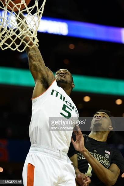 Miami Hurricanes guard Zach Johnson dunks on Wake Forest Demon Deacons forward Isaiah Mucius during the ACC basketball tournament between the Wake...