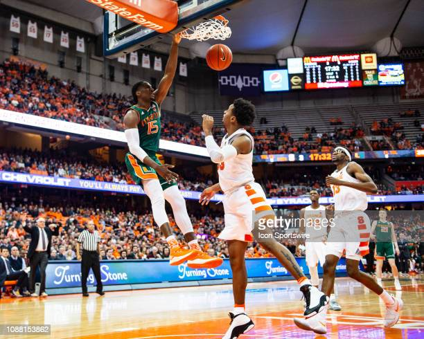 Miami Hurricanes Guard Zach Johnson dunks the ball with Syracuse Orange Forward Elijah Hughes defending during the first half of the Miami Hurricanes...