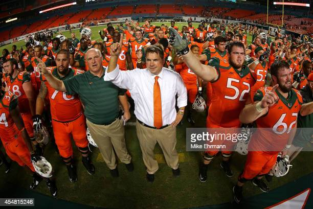 Miami Hurricanes head coach Al Golden cheers with the team after a game against the Florida A&M Rattlers at Sunlife Stadium on September 6, 2014 in...