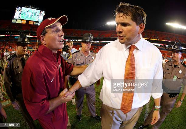 Miami Hurricanes head coach Al Golden shakes hands with Florida State Seminoles head coach Jimbo Fisher after a game at Sun Life Stadium on October...