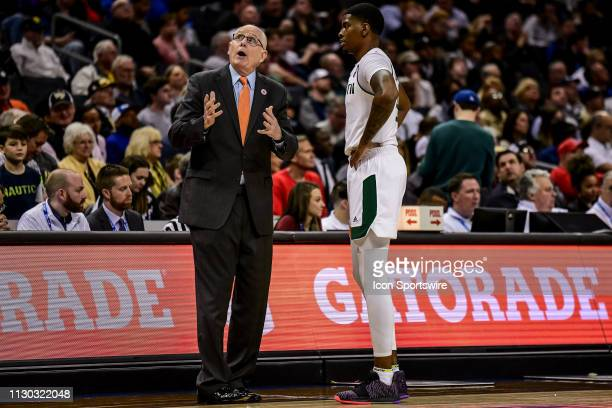 Miami Hurricanes head coach Jim Larranaga talks to Miami Hurricanes guard Anthony Lawrence II during a stop in play during the ACC basketball...