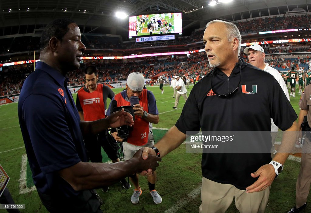 Miami Hurricanes head coach Mark Richt shakes hands with Syracuse Orange head coach Dino Babers during a game at Sun Life Stadium on October 21, 2017 in Miami Gardens, Florida.