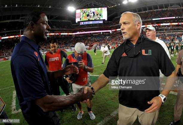 Miami Hurricanes head coach Mark Richt shakes hands with Syracuse Orange head coach Dino Babers during a game at Sun Life Stadium on October 21 2017...